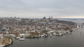 Cityscape, skyline and coastline of Dnieper River near Dnipro city at winter time stock images