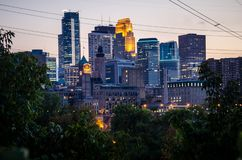 Cityscape skyline of Downtown Minneapolis Minnesota in the Twin Cities Metro area. Long exposure, night. View from St. Anthony Main stock photos