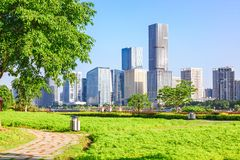 Cityscape and skyline of Fuzhou from green field in park stock images