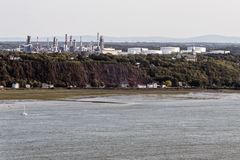 Cityscape or skyline of Saint Lawrence river with Jean Gaulin Oil Refinery from plaines d`Abraham Quebec City Canada Royalty Free Stock Images