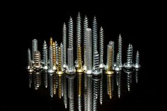 Cityscape skyline. Various screws on end point upward to resemble a cityscape skyline Royalty Free Stock Photography