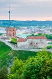Cityscape skyline view on famous Gediminas castle complex and tv tower on the background from Three Crosses Hill panoramic. Vilnius, Lithuania - May 15, 2013 royalty free stock photos
