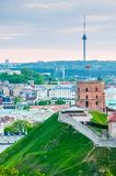 Cityscape skyline view on famous Gediminas castle complex and tv tower on the background from Three Crosses Hill panoramic. Vilnius, Lithuania - May 15, 2013 stock image