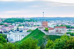 Cityscape skyline view on famous Gediminas castle complex and tv tower on the background from Three Crosses Hill panoramic. Vilnius, Lithuania - May 15, 2013 royalty free stock images