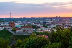 Cityscape skyline view on famous Gediminas castle complex and tv tower on the background from Three Crosses Hill panoramic. Vilnius, Lithuania - May 15, 2013 royalty free stock image