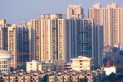 Cityscape in indian city like noida gurgaon delhi. Cityscape with skyscrapers smaller apartment, water tower temple and other items. Typical in an indian city stock image
