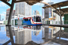 Cityscape and skytrain with their reflections Stock Images