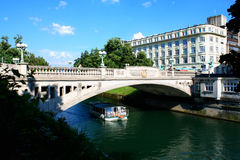 Cityscape of the Slovenian capital Ljubljana. Dragon bridge over Stock Images