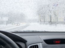 Cityscape in snowfall from the car. The snowy street of Petrozavodks city in Karelia, Russia Stock Photos
