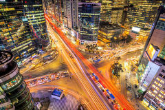 Cityscape of South Korea. Night traffic speeds through an intersection in the Gangnam district of Seoul, Korea. Stock Photo