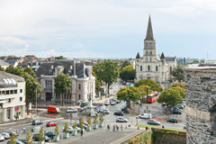 Cityscape with St Laud's Church in Angers, France. ANGERS, FRANCE - JULY 28, 2014: view of Place du President Kennedy, Place de L'Academie and St Laud's Church Stock Photography