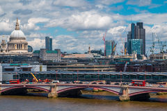Cityscape with St Paul Cathedral and modern buildings in financial district. View of contemporary and old buildings in London with St Paul Cathedral and Royalty Free Stock Image