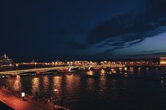 Cityscape of St Petersburg`s Famous Palace Bridge. Across the Neva River at Night royalty free stock photography