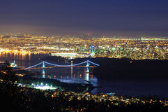 Cityscape with Stanley Park and Lions Gate Bridge Over Burrard Inlet at Evening Blue Hour Stock Image