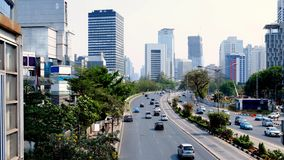 Cityscape of sudirman Street, Jakarta, Indonesia. This road is center of business activity in Jakarta, this road is contain many skyscraper Royalty Free Stock Photo
