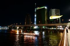 Cityscape with the Sumida River, Tokyo sky tree, Asahi Beer Hall at night royalty free stock image
