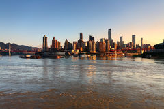 Cityscape in Sunset. The skyscrapers stands by the Jialing and Yangzi river. The landscape in city of Chonqing, westsouth of China royalty free stock photos