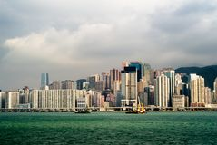 Cityscape of tall buildings near ocean Royalty Free Stock Photography