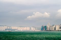Cityscape of tall buildings near ocean Royalty Free Stock Image