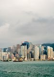 Cityscape of tall buildings near ocean Royalty Free Stock Photos