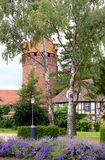 Cityscape of Tangermunde (Saxony-Anhalt, Germany) with its old b. Rick stone jail tower. in front flowerbed of lavendar Royalty Free Stock Photography