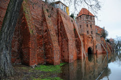 Cityscape of Tangermunde (Saxony-Anhalt, Germany). With its old brick stone town wall. flood of elbe river in early springtime Stock Photos