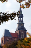 Cityscape of Tangermunde (Saxony-Anhalt, Germany) with St.-Steph. Anskirche church in autumn time. colorful leaves Royalty Free Stock Image