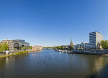 Cityscape with Teerhof on the left and view to the bridge at riv. BREMEN, GERMANY - MAY 13, 2016: Cityscape with Teerhof on the left and view to the bridge at stock photo