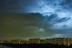 Cityscape at dusk with thunderstorm over apartments buildings Royalty Free Stock Photos