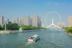 Cityscape of Tianjin ferris wheel,Tianjin eyes with tourist boat Stock Photo