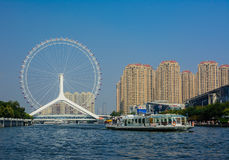 Cityscape of Tianjin ferris wheel,Tianjin eyes with tourist boat Royalty Free Stock Image