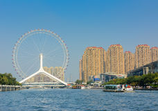 Cityscape of Tianjin ferris wheel,Tianjin eyes with tourist boat Stock Photography