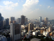 Cityscape - Tokyo. Blue, clouded sky and city as long as you can strech your eyes. View from Tokyo Tower - Roppongi - Tokyo - Japan Stock Photography