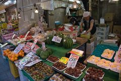 Cityscape Tokyo. Cityscape of Tokyo business district with fruit on sale Stock Photo