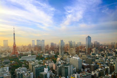 Cityscape of Tokyo, city aerial skyscraper view of office building and downtown of tokyo with sunset / sun rise background. Japan stock photography