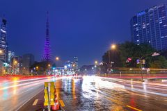 Cityscape of Tokyo with traffic lights and illuminated Tokyo tower, Japan. Tokyo, Japan - November 14, 2016: Cityscape of Tokyo with traffic lights and Royalty Free Stock Image