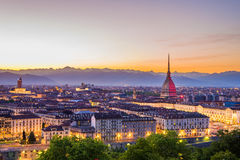 Cityscape of Torino Turin, Italy at dusk with colorful sky. Cityscape of Torino Turin, Italy at sunset with colorful clear sky. The Mole Antonelliana towering on Stock Images