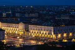 Cityscape of Torino Turin, Italy at night with details of large square Piazza Vittorio Veneto, streets and city lights. Royalty Free Stock Photography