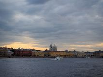 Cityscape of tourist boat carries tourists along the Neva River embankment. royalty free stock photo