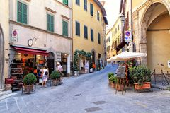 Cityscape with tourists, souvenir shops and cafe in the medieval stock photos