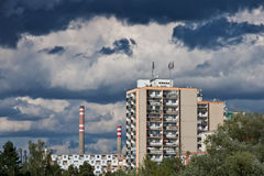Cityscape with tower blocks and factory in background Royalty Free Stock Photos