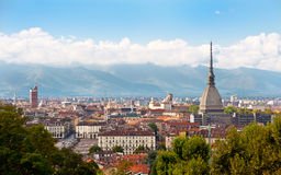 Cityscape of Turin. (Italy) featuring the Mole Antonelliana and the Alps in the background royalty free stock photography
