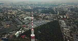 Cityscape with TV tower. Wonderful green cityscape with the TV Tower in Kyiv in Ukraine. Aerial video recording stock footage