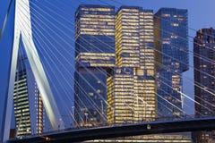 Cityscape at twilight near the Erasmus bridge in Rotterdam stock photo