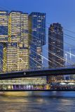 Cityscape at twilight near the Erasmus bridge in Rotterdam royalty free stock images