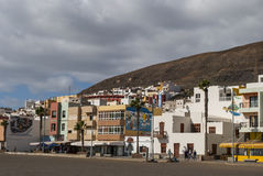 Cityscape. Typical canarian architecture - houses - hill - cloudy sky - Fuerteventura, Canary Islands, Spain Royalty Free Stock Images