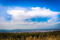 Cityscape under the cloudy sky Stock Photography