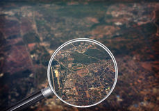 Cityscape under magnifier Stock Images