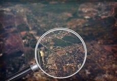 Cityscape under magnifier Stock Images