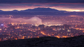 Cityscape under smoke during sunset. With polluted air Royalty Free Stock Photography